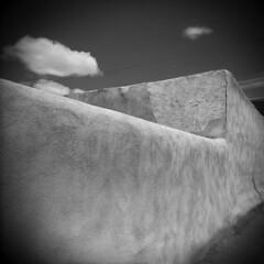 Albuquerque #1 (LowerDarnley) Tags: newmexico southwest wall architecture clouds holga albuquerque minimal adobe buiding