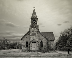 Lost Springs Church Revisted (explore) (unknown quantity) Tags: clouds sky deterioration infrared monochrome neglected weathered winter weathervane exposedmetal cloudsstormssunsetssunrises hss baretrees peelingpaint exposedwood fadedpaint