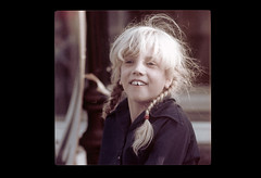 ss23-35 (ndpa / s. lundeen, archivist) Tags: portrait people color film girl face boston child massachusetts nick slide blond blonde slideshow mass pigtails 1970s bostonians bostonian chippedtooth dewolf early1970s nickdewolf photographbynickdewolf slideshow23
