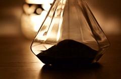 Like sands thru the hourglass (Dale Gillard) Tags: light macro glass sand candle melbourne victoria maidstone hourglass productphotography