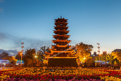 Zhangye Twilight and Wooden Pagoda. (baddoguy) Tags: longexposure blue sunset flower horizontal architecture outdoors photography pagoda twilight stupa religion tranquility buddhism nopeople illuminated silkroad backlit copyspace ancientcivilization cultures chrysanthemum flowerarrangement chineseculture traveldestinations colorimage famousplace locallandmark gansuprovince buildingexterior nationallandmark frontorbackyard templebuilding builtstructure chinaeastasia woodmaterial