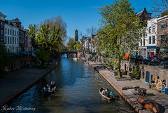 Oudegracht Utrecht, Holland (Gainesvilledutchie) Tags: city blue sky sun holland church water netherlands photography boat canal spring europe utrecht domtoren dom nederland sunny historic dome boating historical