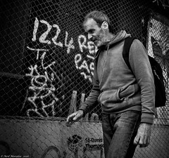 1224 (Neil. Moralee) Tags: poverty street old portrait people blackandwhite bw white man black monochrome face fence dark walking graffiti mono hoodie nikon alone outdoor candid homeless neil chain chainlink mature worn lonely unhappy wrinkles unemployed unshaven 1224 bloke weatherbeaten downtrodden cashless haggared d7100 moralee
