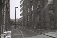 Lolesworth Close (goodfella2459) Tags: white black london history film analog 35mm lens nikon close plus 24mm af nikkor whitechapel milf ilford fp4 f4 125 f28d floweranddeanstreet lolesworth