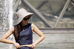 Pretty enough? (World Around Richa) Tags: paris france smile hat sunglasses fashion french photoshoot louvre fancy denim pearl bangle trend oriental prettywoman pearlnecklace chineselady pinknails beautifulsmilinglady