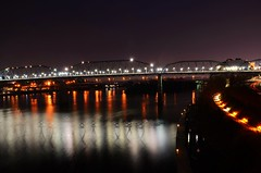 Light & Reflection (Roland 22) Tags: blue orange white black reflection chattanooga water yellow lights flickr glow purple tn tennessee horizon northshore lighttrails lamps walnutstreetbridge lightshow tennesseeriver bluffview