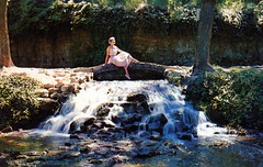 Big Spring Park Neosho MO (Edge and corner wear) Tags: park people woman water vintage waterfall pc sitting state postcard scenic social chrome cascade feature