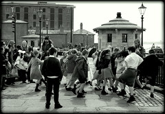 Dancing in the dock (* RICHARD M (5 million views)) Tags: street music childhood architecture liverpool docks children fun happy mono blackwhite waterfront dancers dancing action streetlamps streetlights candid joy performance smiles happiness unescoworldheritagesite cobblestones entertainment innocence docklands entertainer lamps schoolchildren schoolkids cobbles performer scousers violinist endearing albertdock happydays groups joyous youngsters merseyside lampposts funandgames evocative spontaneity capitalofculture joiedevivre dancinginthestreet thedecisivemoment kidsbeingkids europeancapitalofculture liverpudlians halcyondays childrendancing dancingchildren timeoftheirlives unescocityofmusic unescomaritimemercantilecity buskingviolinist