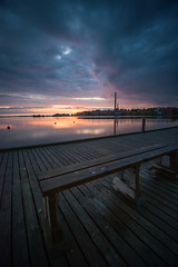 Sunset at the docks (AlexanderHorn) Tags: ocean sunset sun seascape beautiful rain clouds finland bench dock sundown visit serene vaasa sterbotten