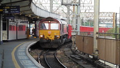 DB 66053 (North West Transport Photos) Tags: train manchester piccadilly db 66 manchesterpiccadilly freighttrain class66 ews diesellocomotive 66053 dbschenker middletontowers arpleysidings 693z