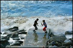 Racing the tide. (Frank Fullard) Tags: ocean ireland boy sea irish clare tide atlantic lahinch fullard frankfullard