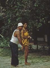 Man and woman playing  boules in Tahiti (D70) Tags: woman playing man 1st steel pipe july balls smoking 1967 tahiti boules papeete wahine ptanque boulestahiti