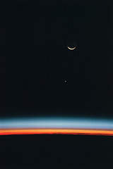 Crescent Moon and Jupiter over Earth's Horizon