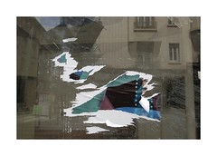 .. (lux fecit) Tags: paris reflection window poster reflet torn