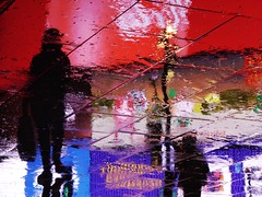 Circus Ghosts XIX (Douguerreotype) Tags: street city uk light red england people urban reflection london tourism water rain silhouette night umbrella lights upsidedown britain piccadillycircus gb british urbex