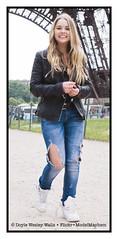 Britney, All Smiles as She Walks Away from the Eiffel Tower (Doyle Wesley Walls) Tags: bb 0202 woman girl female mdchen ragazza flicka fille dziewczyna chica ena mujer femme kobieta donna femenino fminin weiblich femminile kvinna teen portrait photograph feminine beautiful beau pikny bonita hermosa guapa vacker smuk kaunis bonito lindo frumos mooi schn skjnn fallegur bello sexy sduisant seksowny seductor sexig sexet  blonde rubia retrato ritratto portrt portret smile sonrisa lcheln sourire sorriso glimlach umiech face cara faccia gesicht longhair tornjeans britney doylewesleywalls joyful playful charm beauty landmark