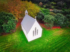White Church From Above (Stuck in Customs) Tags: manowar newzealand northisland stuckincustomscom treyratcliff waiheke treyratcliffcom auckland nz hobbiton waihekeisland north island dailyphoto rr horizontal colour color daytime day trey ratcliff cliff sea ocean capital forest country hdr hdrphotography hdrphoto outdoor outdoors outside quad phantom 4 dji white grey blue green brown yellow luxury may 2016 landscape crag shore coast rock bluff ridge seaside rockformation black view bay clouds forrest water trail fc330 p2016 hill
