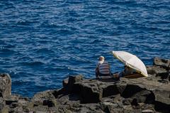 blues (inma F) Tags: agua lossilos mar fisherman pescador costa sombrilla tenerife roca