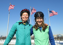 Rhiannon and Lis with Flags (Mr.TinDC) Tags: friends people cyclists washingtondc dc flags americanflags washingtonmonument lis rhiannon flagpoles