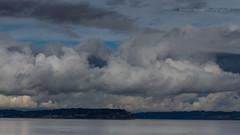 Black Hole. (Brendinni) Tags: sky water clouds washington traces land pugetsound blueskies southwhidbeyisland