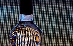 (fasanelloelizabeth) Tags: light abstract color macro window lines design bottle pattern drink naturallight alcohol windowsill liquid windowlight brightcolor lightpattern