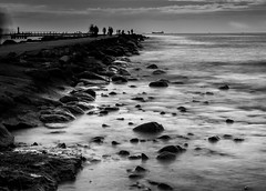 Breakwater Port of Riga (Andris Nikolajevs) Tags: ocean longexposure sunset sea people blackandwhite white seascape black beach water monochrome landscape mono evening pier rocks long exposure latvia breakwater nikond3300