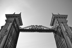 Entrada a contraluz (itslour) Tags: backlight contraluz factory gates columns castiron cigarettes pillars azulejo malaga bwphotography puertas columnas pilares tabacalera hierroforjado