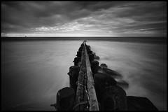 Balance (DJawZ) Tags: ocean blackandwhite bw clouds pier long exposure jetty atlantic