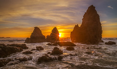Breaking Through (Simon Huynh) Tags: california sun water rock clouds wave rodeobeach sunstar