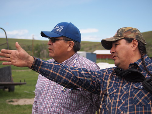 Winston Bruised Head (Left) speaks with one of the Bison Ranchers
