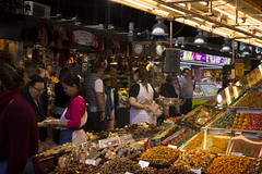 Mercat de Sant Josep de la Boqueria, Barcelona (johnjduncan) Tags: barcelona people espaa food woman man fruit spain europe european candy market sweet sale chocolate nuts stall catalonia goods meat espana sweets customer catalunya seller stalls catalua buyer mercat trader transaction