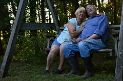 True Love (TheCozyEscape) Tags: trees portrait people silly love face goofy forest bench wooden scenery couple emotion boots expression environmental scene relationship elderly age sit environment feeling truelove timeless environmentalportrait elderlycouple