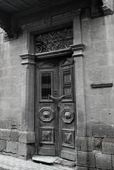 THE door (marilenaxiari) Tags: old city blackandwhite bw abandoned broken nikon lock cyprus chain oldtown bnw olddoor d60 nicosia lefkosia brokendoor  lockeddoor    thechallengefactory