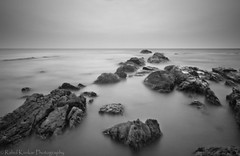 Seascapes (rahul_2800) Tags: longexposure sunset india rocks seascapes goa beaches hoya vagator sigma1020mm sigma1020 hoyandfilter hoyandx400 canon550d rahulkinikar