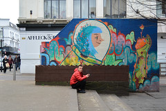 DSC_0588-1 Tib Street, Manchester, uk (Lawrence Holmes.) Tags: street uk manchester nikon eyecontact northernquarter streetphotography kitlens 1855 clocked nq d5200 lawrenceholmes
