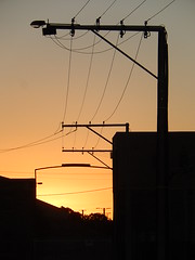 Wired Sunset (mikecogh) Tags: sunset silhouette glow wires telegraphpoles portadelaide