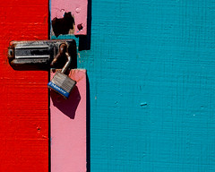 Lock (justtakenpictures(with a new macro)) Tags: door colors pink red blue lock pacificbeach sandiego california justtakenpictures paint print 15challengeswinner rock1 nothumbs challengegamewinner no3game gamex3