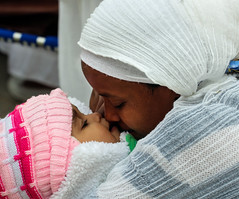 """""""There is no such thing as a baby ..."""" (ybiberman) Tags: portrait baby hat easter israel kiss veil candid jerusalem mother streetphotography closeness oldcity pilgrim alquds ethiopian ethiopianchurch christianquarter"""