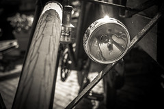 Lucifer (Peter Jaspers) Tags: light blackandwhite bw reflection monochrome bike bicycle vintage blackwhite lucifer dof zwartwit bokeh tire olympus panasonic vest omd sunflare bikelight bogen gouda selfie dynamo 2016 fietsband em10 gouwe 20mm17 buurtje 100bicyclesproject frompeterj