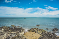 (Ailís Ní hÉgeartaigh) Tags: world blue ireland sea summer seascape beach water beautiful rock clouds zeiss landscape outside boat europe outdoor earth sony bluesky shore beaches land blueskies za wexford a7 2016