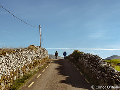 Last evening stroll (Conor O'Reilly) Tags: road ireland irish green stone rural walking landscape countryside nikon scenery bluesky farmland kerry lane april fields waterville dslr uphill walkers drystonewalls 2015 greenfields nikkor35mmf18 d5100