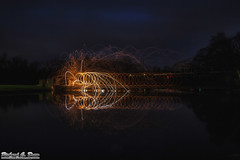 Steel / Wire wool spinning over water (RickDrew) Tags: bridge orange hot reflection wool water night dark circle evening wire melting glow spiders steel spinning heat swirl sparks bounce riccochet