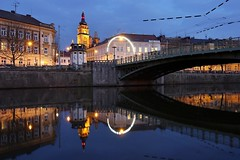 Bl v a Prask most z nplavky (safris76) Tags: old city longexposure travel bridge blue light reflection tower public water lamp architecture night clouds river mirror europe darkness czech walkway bluehour oldtown elbe whitetower historicalbuilding banisters hradeckralove