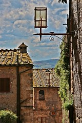 Lampposts and alleys (Emanuele Barcali) Tags: vacation sky italy sun black green tower love clouds countryside photo san artist view gimignano weekend withe sunny medieval hills tuscany sangimignano castello borgo castel torri blackwithe togheter