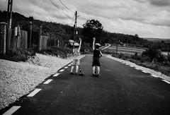 IMG020.jpg (andrei_pietru) Tags: street clouds village hills nikonf4 ilforddelta100