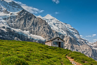 The hut of Mittellegi and the   Jungfrau mountain.The Eiger Trail. No. 7923.