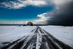 a storm is coming (krelina) Tags: ocean road old travel blue schnee sea sky house snow storm ice weather clouds island iceland nikon meer path ruin himmel wolken adventure ruine blau schneesturm sturm snaefellsnes lostplace d5100