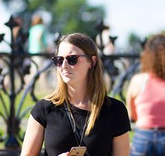 iphone & sunglasses (O Harris) Tags: girl brunette lady woman iphone sunglasses fence lawn parliament ottawa canada tshirt blacktop canon sunny summer 2016 seora dame  ragazza