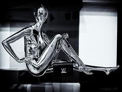 Metropolis Fashionista (evanffitzer) Tags: blackandwhite bw mannequin window fashion silver wow shopping mono robot shiny bright display lasvegas nevada chrome purse future figure metropolis fujifilmx100s