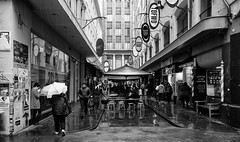 melbourne rain (keith midson) Tags: road street city people urban wet rain umbrella streetphotography australia melbourne lane cbd raining outdoordining campbellarcade